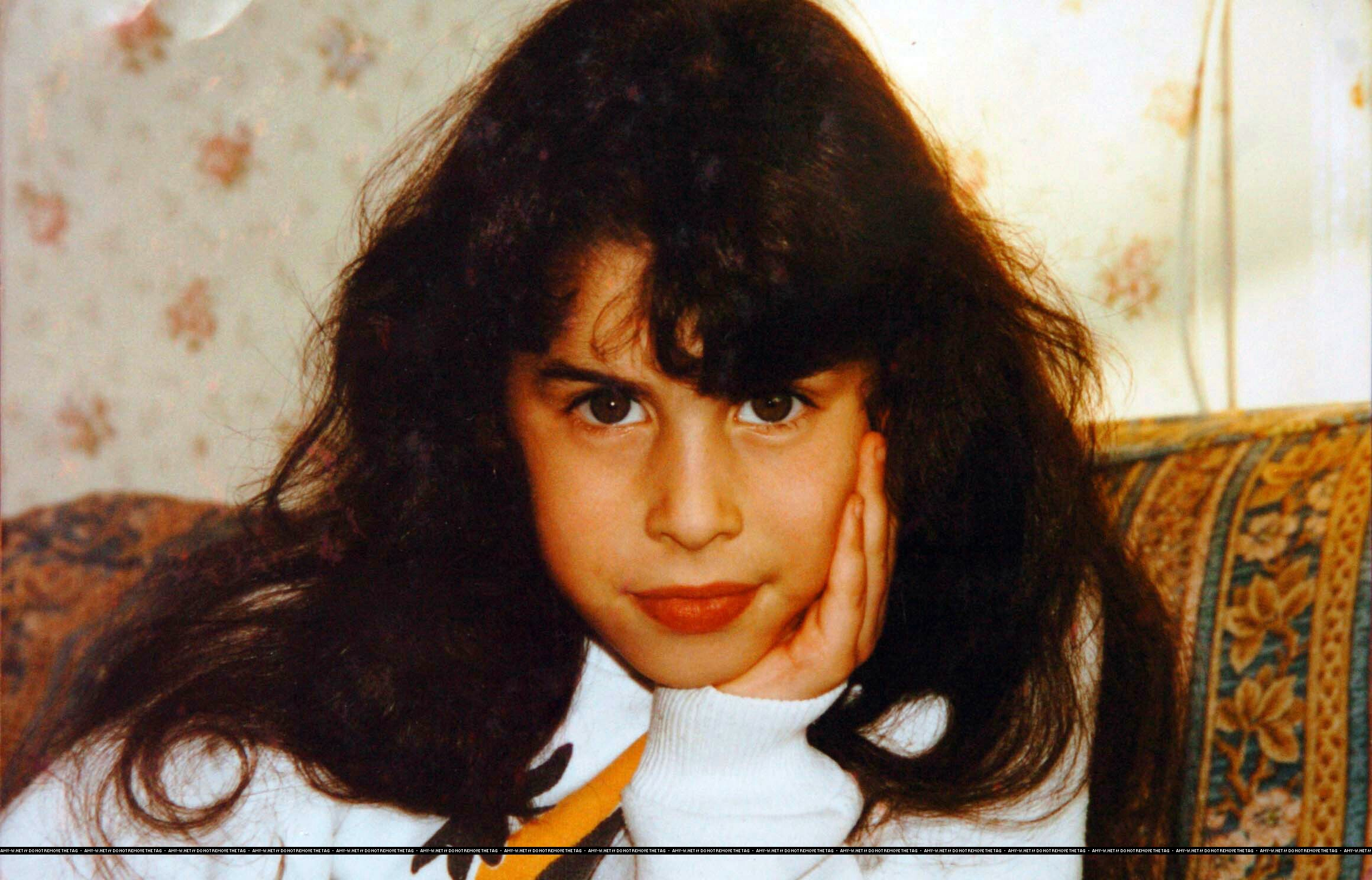 Amy Winehouse, the award-winning singer, seen in these candid shots from her childhood. Amy is reportedly attending rehab at the world-famous Meadows Clinic in Arizona for drinks and drug addiction. Pictured: Amy Winehouse aged 10 Ref: NSTUK 150807 A EXCLUSIVE Splash News and Picture Agency does not claim any Copyright or License in the attached material. Any downloading fees charged by Splash are for Splash's services only, and do not, nor are they intended to, convey to the user any Copyright or License in the material. By publishing this material , the user expressly agrees to indemnify and to hold Splash harmless from any claims, demands, or causes of action arising out of or connected in any way with user's publication of the material. Splash News and Pictures Los Angeles: 310-821-2666 New York: 212-619-2666 London: 207-107-2666 photodesk@splashnews.com www.splashnews.com