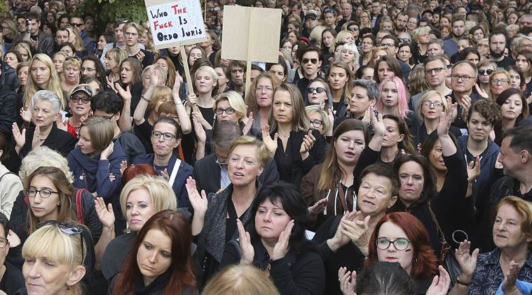 People attend the anti-government, pro-abortion demonstration in front of Polish Pariament in Warsaw, Poland, Saturday, Oct. 1, 2016. (AP Photo/Czarek Sokolowski)
