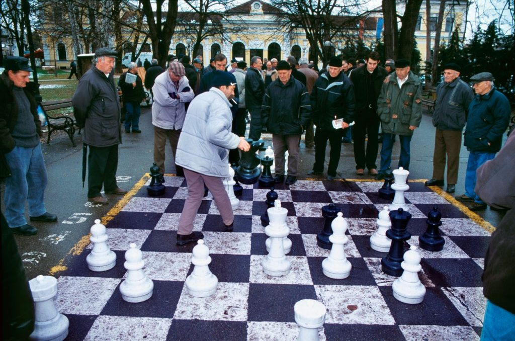 Elderly men playing Street Chess on a giant checkerboard. Banja Luka, Republic of Serbia, Bosnia an