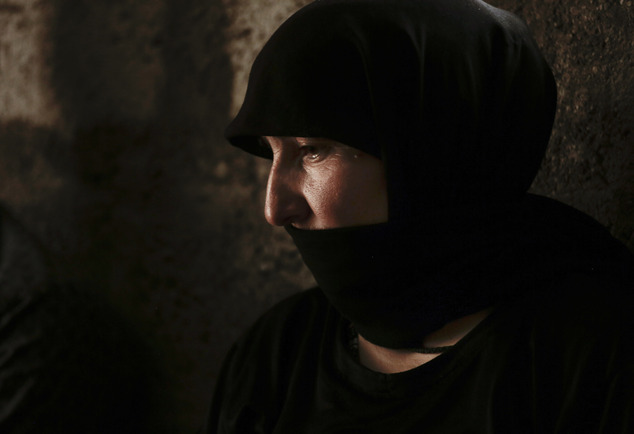 Nuri Murat, a Yazidi woman, speaks to The Associated Press at Kankhe Camp for the internally displaced in Dahuk, northern Iraq, in this May 18, 2016, photo. When Islamic State group militants overran Yazidi villages and towns in August 2014, they killed her husband and abducted her daughter, Nazdar, one of thousands of Yazidi girls and women enslaved by the group. Nazdar was about 16 at the time. Her fate remains unknown. (AP Photo/Maya Alleruzzo)