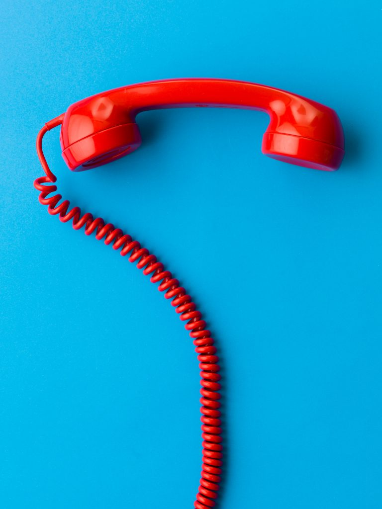 red phone receiver on blue background