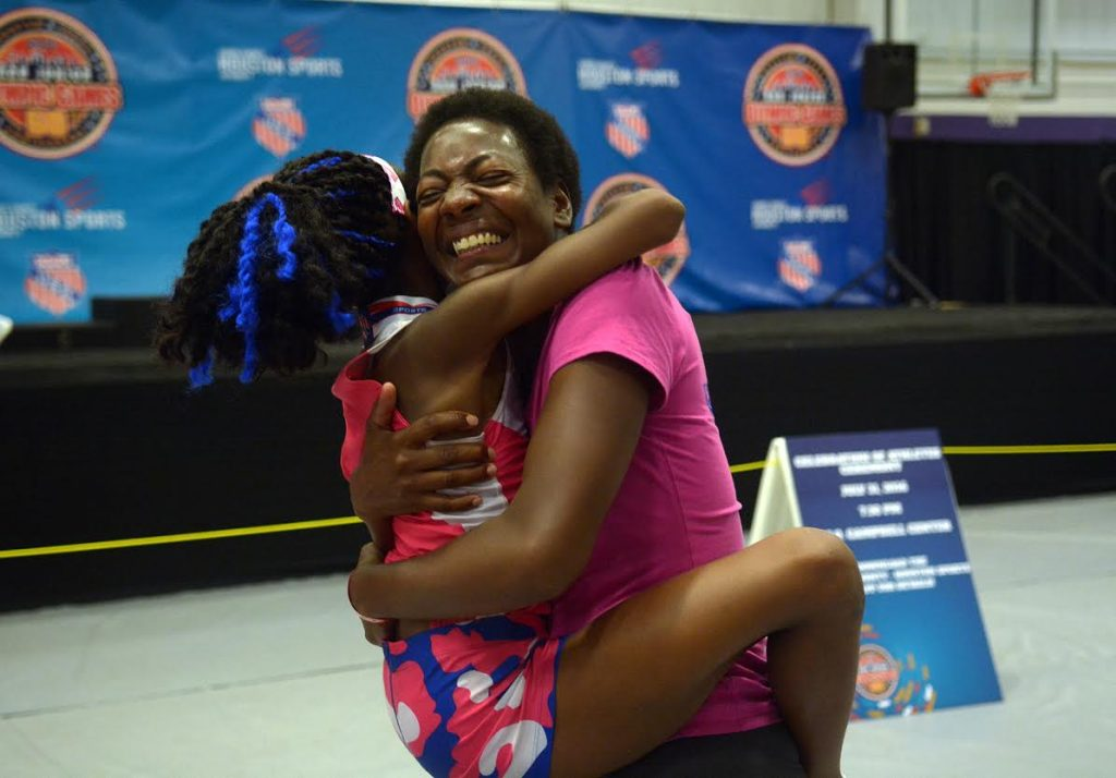 Juennes Track Club athlete Rainn Sheppard, 10, left, of Brooklyn, N.Y., shares a hug with her mom, Tonia Handy, who suprised Rainn by showing up to watch her compete in the Girls 3000 Meter race at the 2016 AAU Junior Olympic Games at Turner Stadium in Humble, Texas, on Monday, Aug. 1, 2016. The biggest surprise Monday for Sheppard, competing at the Junior Olympics in Houston and far from the New York City homeless shelter she shares with her two sisters and mother, wasn't the gold medal she won in the 3,000 meters. It was the arrival of her mother.(Jerry Baker/Houston Chronicle via AP)